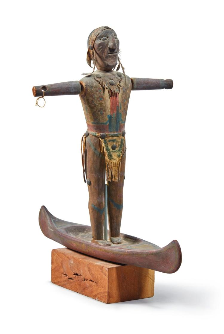 AMERICAN CARVED AND PAINTED WHIRLIGIG IN THE FORM OF AN AMERICAN INDIAN STANDING IN A CANOE, LATE 19TH CENTURY |