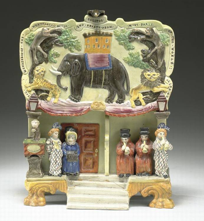 A STAFFORDSHIRE PEARLWARE GROUP OF POLITO'S MENAGERIE CIRCA 1835