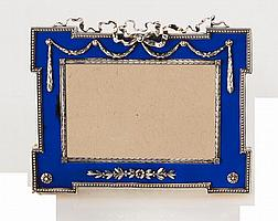 A FABERGÉ SILVER AND BLUE ENAMEL PHOTOGRAPH FRAME, WORKMASTER: JOHAN VICTOR AARNE, ST PETERSBURG, 1899-1908