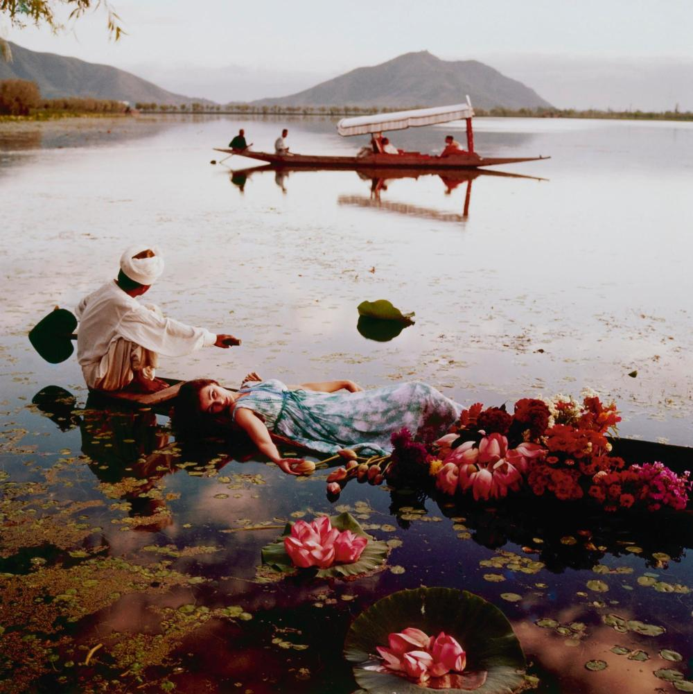 NORMAN PARKINSON | Floating with Flower, Dal Lake, Kashmir II, India, Vogue, 1956