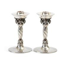 A pair of Danish sterling silver 'Grapevine' pattern candlesticks, No. 263A, designed by Georg Jensen, post 1945 manufacture 716 gms.