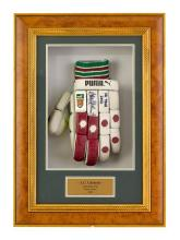 A Puma batting glove, used during the Australian Cricket Tour to South Africa in 2002, signed by Adam Gilchrist 52.5 cm high, 37.5 c...