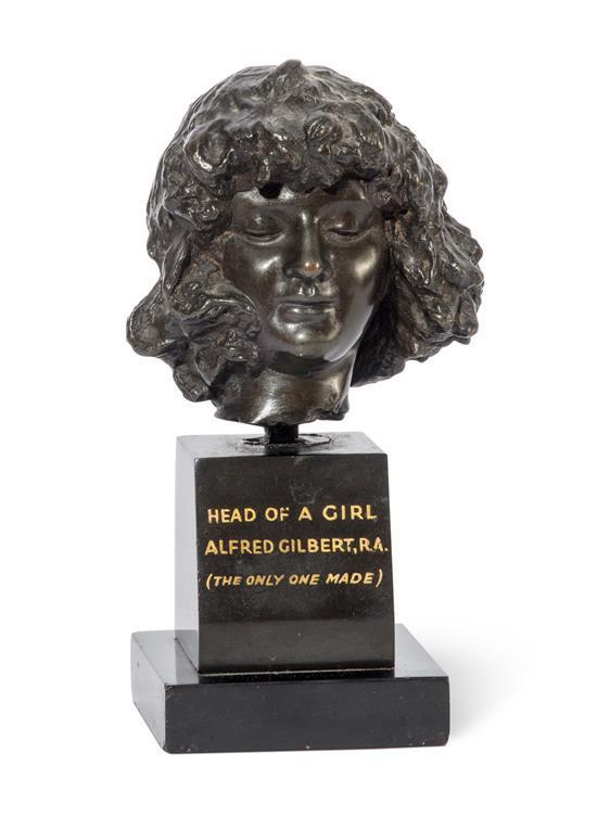 SIR ALFRED GILBERT, R.A. 1854-1934 Head of a Girl bronze 7.6 cm high