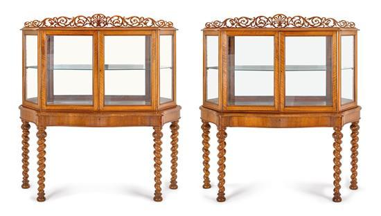 A fine pair of Victorian walnut display cabinets, circa 1870 (2)