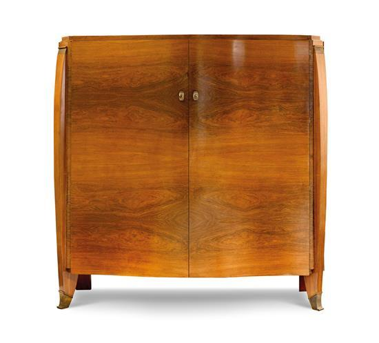 Attributed to Jules Leleu A French rosewood and gilt bronze cabinet, circa 1935