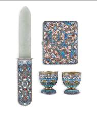 A Russian silver and cloisonne enamel handled paper knife, a silver and cloisonne cigarette case and two silver gilt and enamel egg...