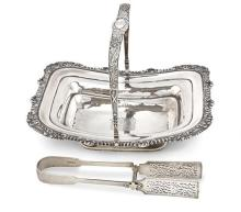 A George lV silver cake basket, Soloman Hougham, London, 1822 and a pair of William lV silver asparagus tongs, probably Mary Chawner...