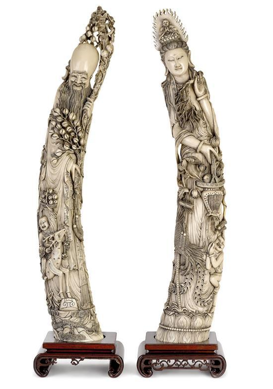 A pair of large and impressive carved ivory tusk figures, early 20th century (4)