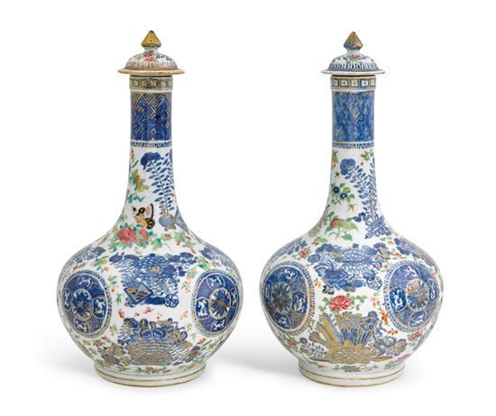 A pair of underglaze blue and enamelled bottle vases and covers Qing dynasty, 18th/19th century (4)