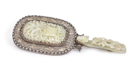 A pale celadon jade and silver mounted mirror, the jade Qing dynasty, 19th century