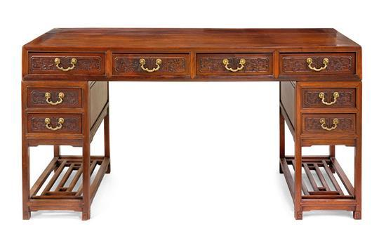 A carved hardwood pedestal desk, 19th/20th century