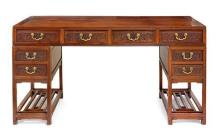 A carved hardwood pedestal desk, 19th/20th century