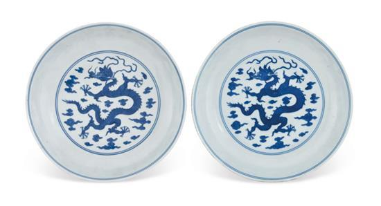A pair of blue and white 'dragon' dishes Qing dynasty, 19th century (2)