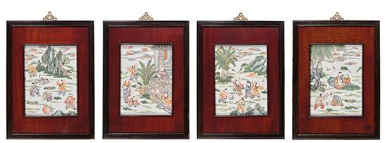 A set of four 'famille-rose' 'boys' porcelain plaques, 20th century (4)
