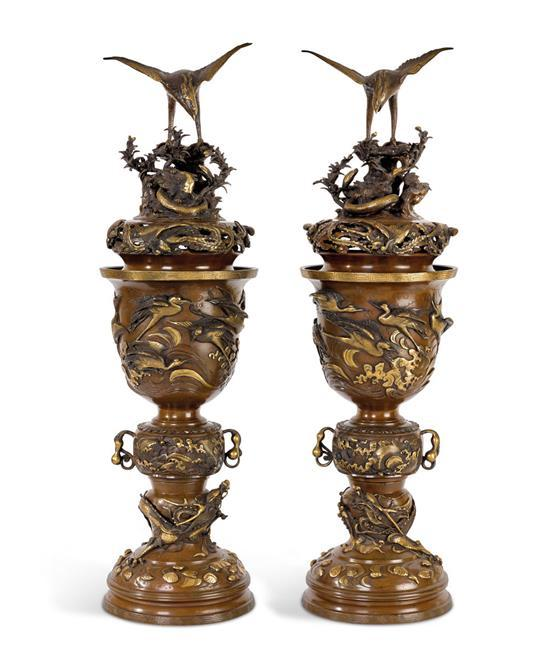 A pair of Japanese bronze and partially gilt covered censers, late 19th century (6)