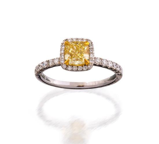 18ct white gold, fancy yellow diamond and diamond ring