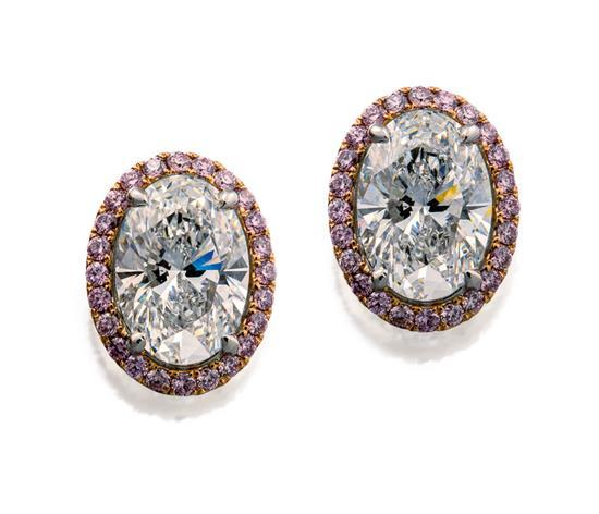 Pair of platinum, diamond and Argyle fancy purplish pink diamond earrings