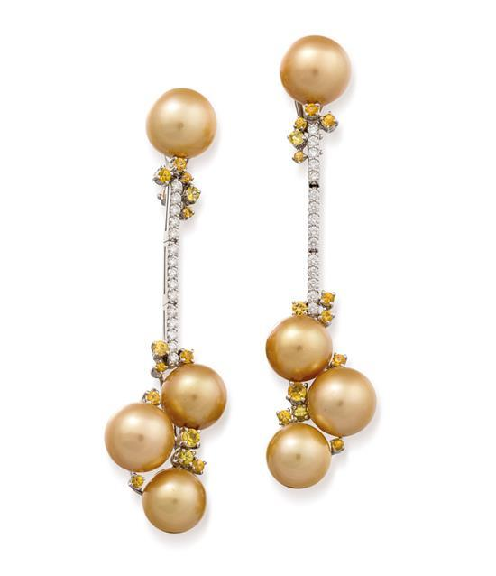 Pair of 18ct white gold, golden south sea pearl, yellow sapphire and diamond pendant earrings, Paspaley