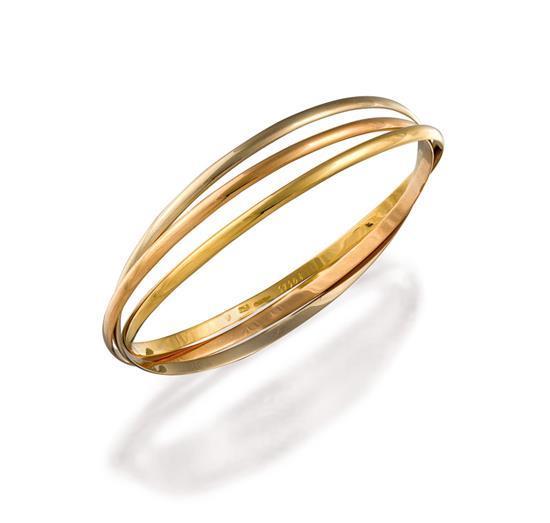 18ct tri-colour gold ''Trinity'' bangle, Cartier