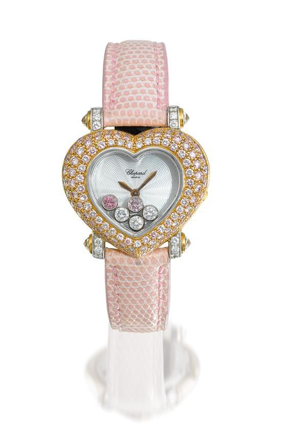 Chopard A lady''s 18ct gold and pink diamond and diamond-set heart-shaped wristwatch case ref 20/6602-403 case 490073550 Happy Diamon..