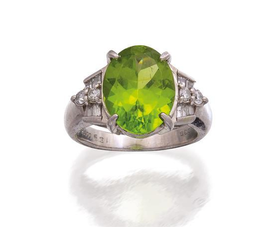Platinum, peridot and diamond ring