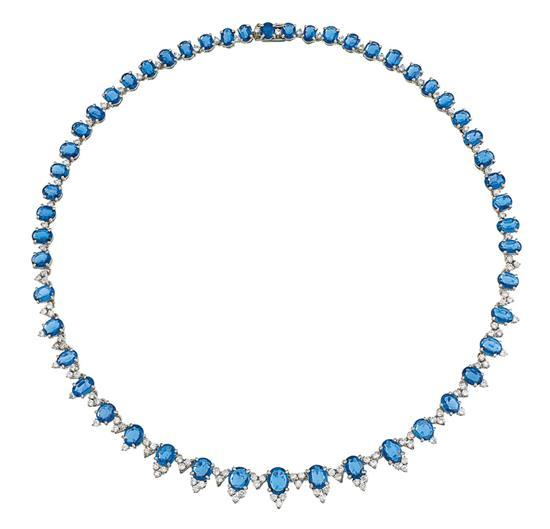 14ct white gold, sapphire and diamond necklace