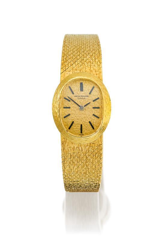Patek Philippe A lady''s 18ct gold bracelet watch ref 4111/1 mvt 999150 case 519930 circa 1970