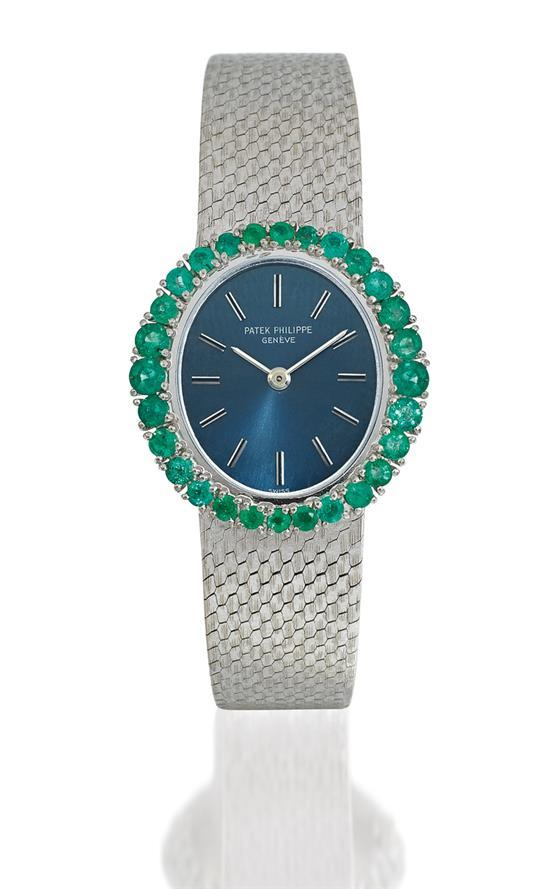 Patek Philippe A lady''s 18ct white gold and emerald-set bracelet watch ref 3396/1 mvt 997895 case 2678644 circa 1970