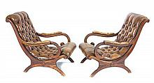 A pair of leather upholstered open arm reading chairs, late 19th century (2)
