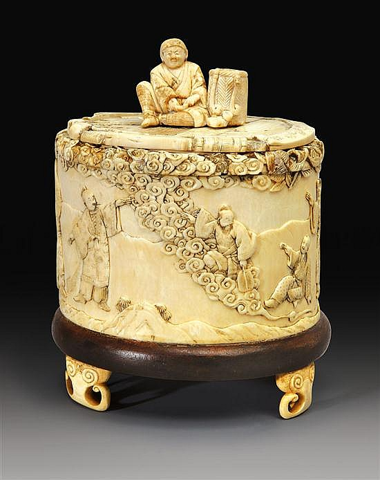A carved ivory box and cover meiji period