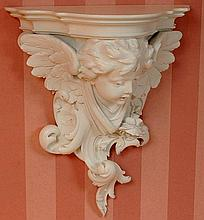 PAIR CARVED AND PAINTED WOOD CHERUB FIGURAL SHELVES