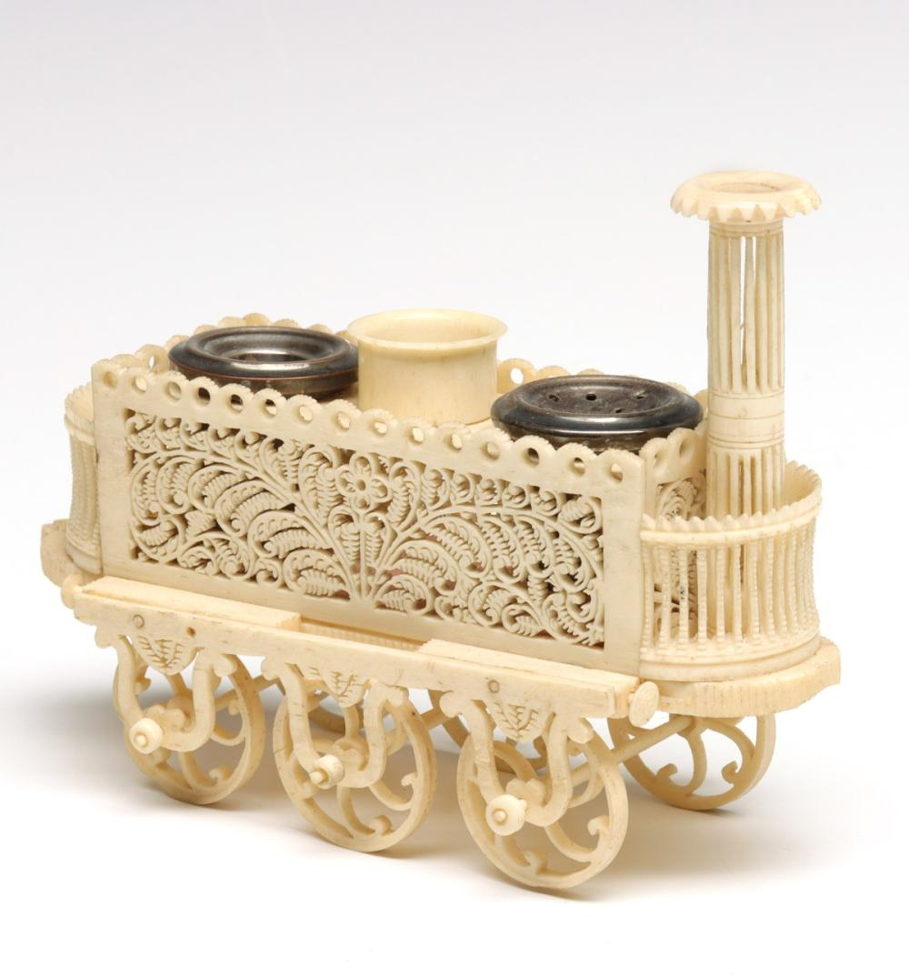 A FINELY CARVED DIEPPE LOCOMOTIVE FORM INKWELL