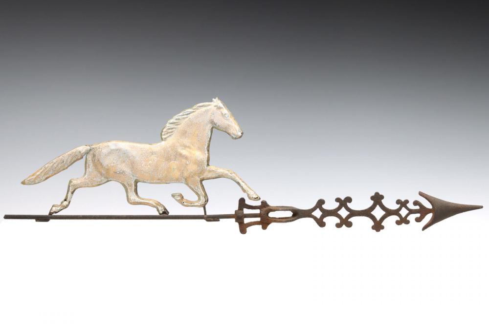 A LIGHTNING ROD WEATHER VANE WITH TROTTING HORSE