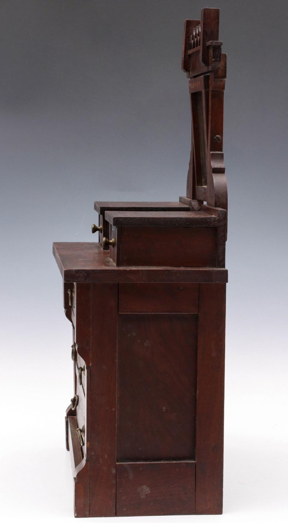 A MINIATURE 19C FOLK ART OR APPRENTICE DRESSER MODEL