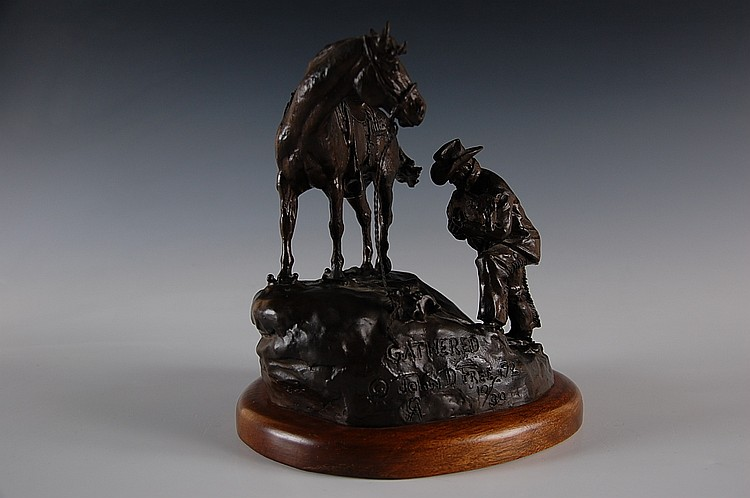 JOHN D. FREE (American born 1929) BRONZE SCULPTURE COWBOY AND HORSE