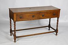 C. 1900 ENGLISH OAK TWO DRAWER CABINET WITH BARLEY TWIST LEGS