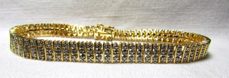 GENUINE DIAMOND GOLD ON STERLING SILVER BRACELET