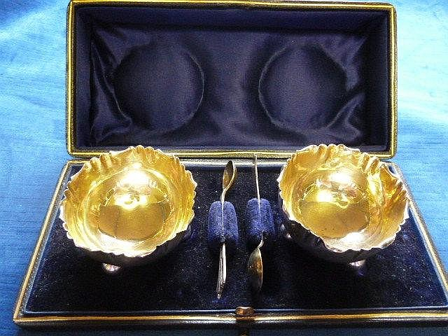 A pair of Victorian silver salts, presented in a