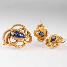 An antique enamel diamond jewellery set with brooch and pair of earrings