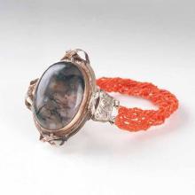 An antique coral bracelet with amulet
