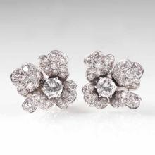 A pair of fine flower shaped diamond earrings