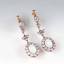 A pair of Art Nouveau opal diamond earpendants