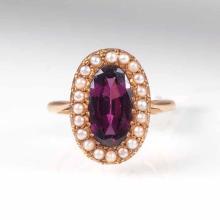 An Art Nouveau rhodolith pearl ring