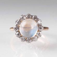 A moonstone ring with old cut diamonds