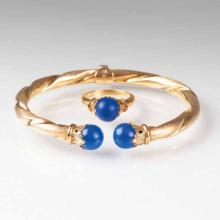 A golden bracelet and ring with lapis lazuli
