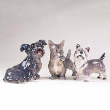 A set of 3 porcelain figures 'Cairn terrier, Scottish terrier and Skye terrier'