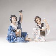 Two porcelain figures 'Juggling or making music Geisha'