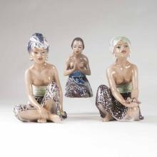 A set of 3 porcelain figures 'Malayan woman, oriental fruit seller and girl from Bali'