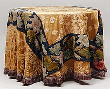 Gold Damask and Needlepoint Table Cloth Covered Table
