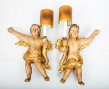 Pair of Italian Rococo Style Painted and Parcel-Gilt Wood Cherub-Form Wall Sconces